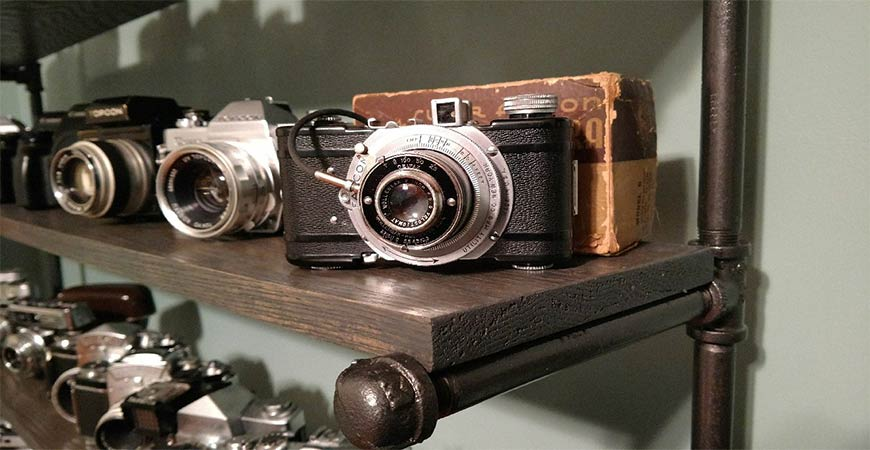 Close up of vintage camera on DIY shelving unit