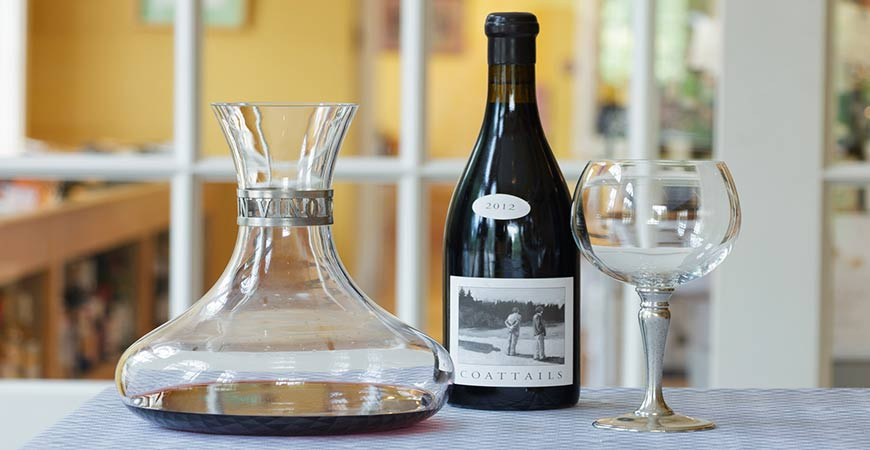 A wine decanter is a unique type of glass to use for a water garden