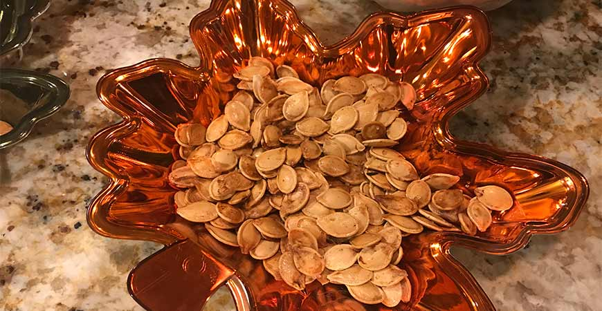 Place pumpkin seeds in bowl