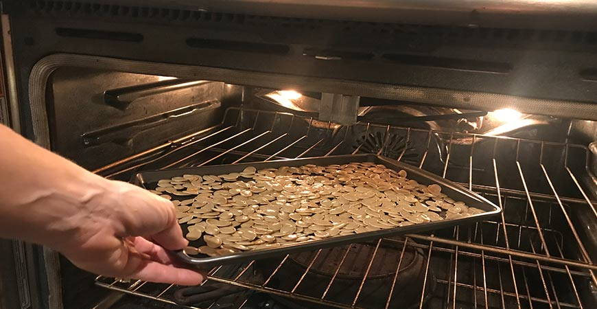 Put pumpkin seeds into the oven