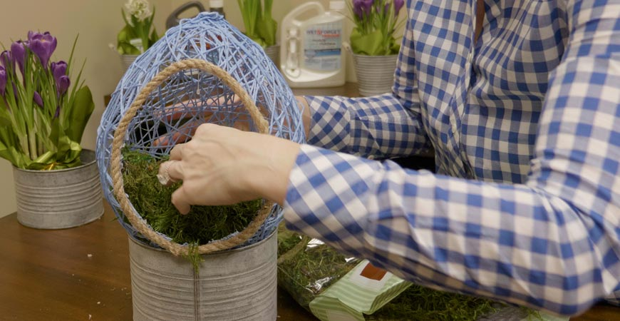 Stuff the basket with faux moss or grass