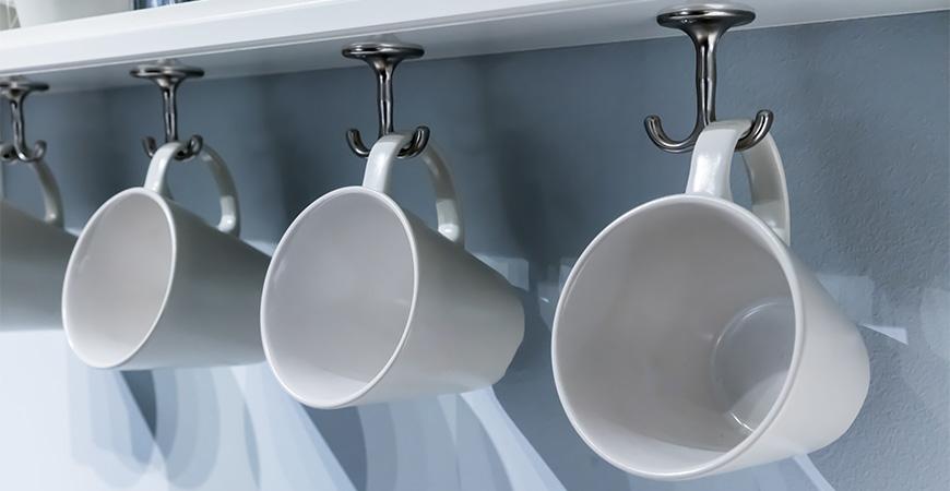 Store mugs on hooks under cabinets.