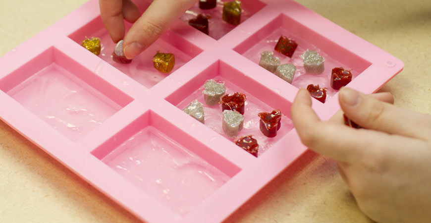 Place plastic hearts on top of your glycerin soap base.