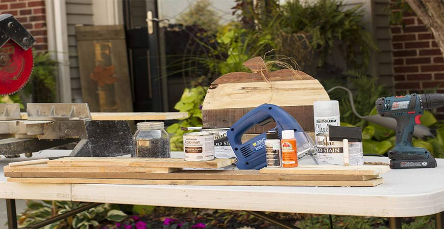 Gather your materials for your DIY pallet pumpkin