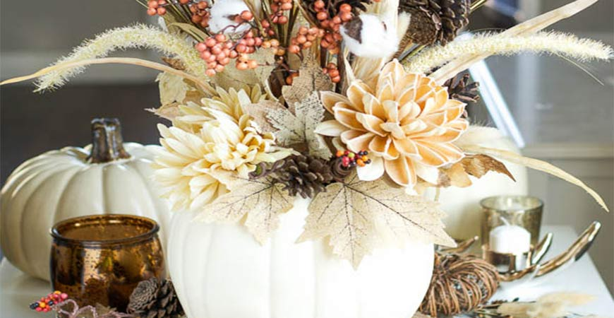 This DIY pumpkin vase will make the perfect center piece for your farmhouse Thanksgiving.