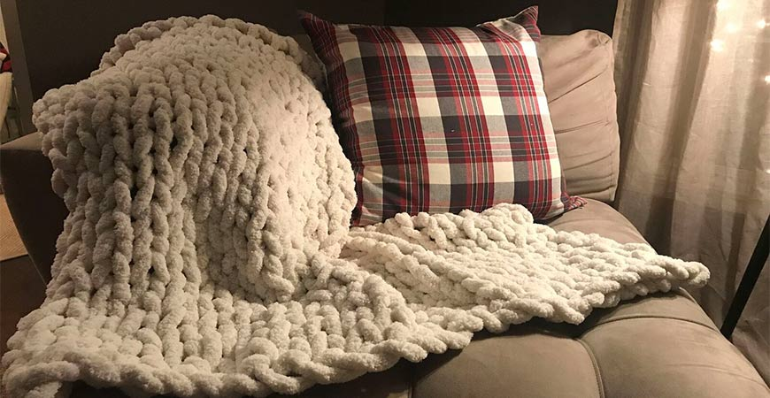 This DIY knit blanket is the perfect addition to any room.