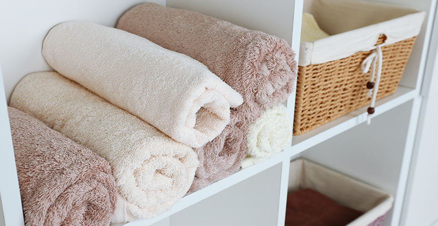 Small shelving units are an easy way to store large items and help organize your bathroom.