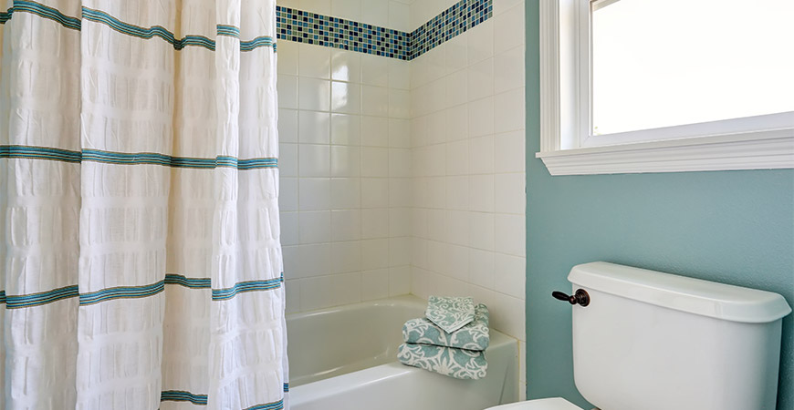 Cloth shower curtains create a stylish new look for your bathroom.